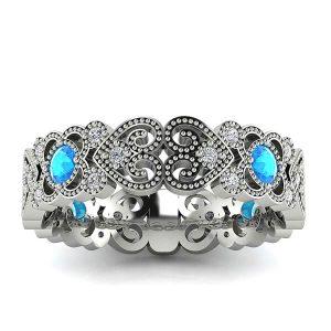 Wzorzyste piękno - Ażurowa obrączka ślubna z białego złota z topazami i diamentami