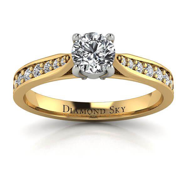 Świeża klasyka - Pierścionek z żółtego i białego złota z diamentem 0,55 ct SI1/H