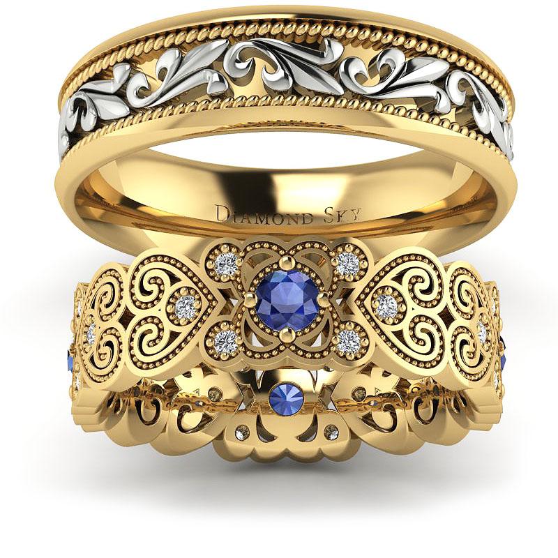 Wzorzyste bogactwo - Obrączki ślubne z żółtego i białego złota z diamentami i szafirami