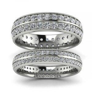 Uroczysty blask - Komplet obrączek ślubnych z białego złota z diamentami