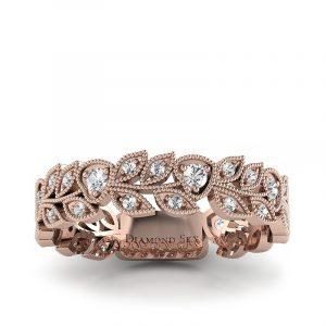 Naturalne piękno - Ażurowa obrączka ślubna z różowego złota z białymi szafirami