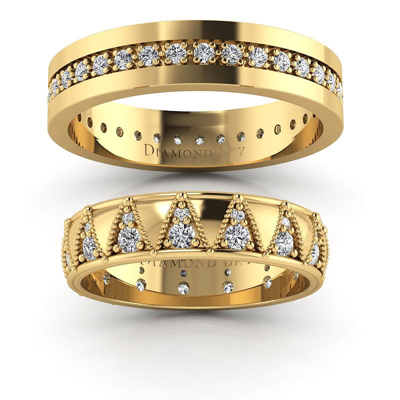 Tajemniczość diamentów - Obrączki ślubne z żółtego złota z diamentami 0,83 ct SI1/H, 5mm