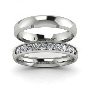 Diamentowa nuta - Komplet półokrągłych obrączek ślubnych z białego złota z diamentami